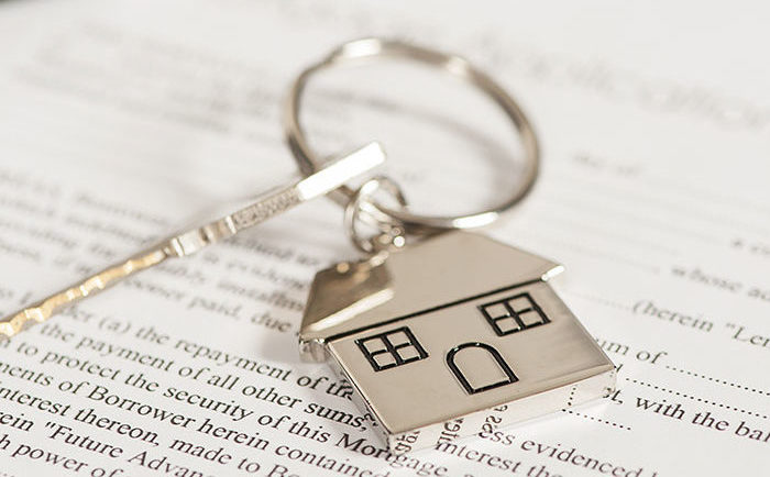 House keychain on top of tenant lease agreement