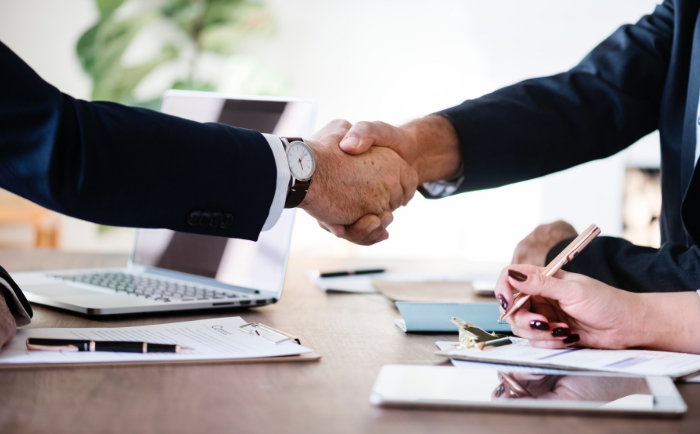 handshake after signing a commercial lease agreement